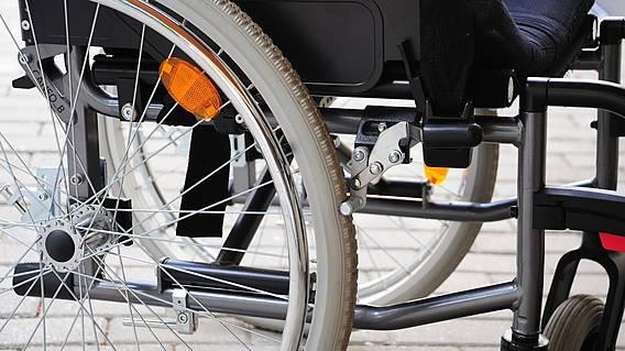 Das Bild zeigt einen Teil eines Rollstuhls.